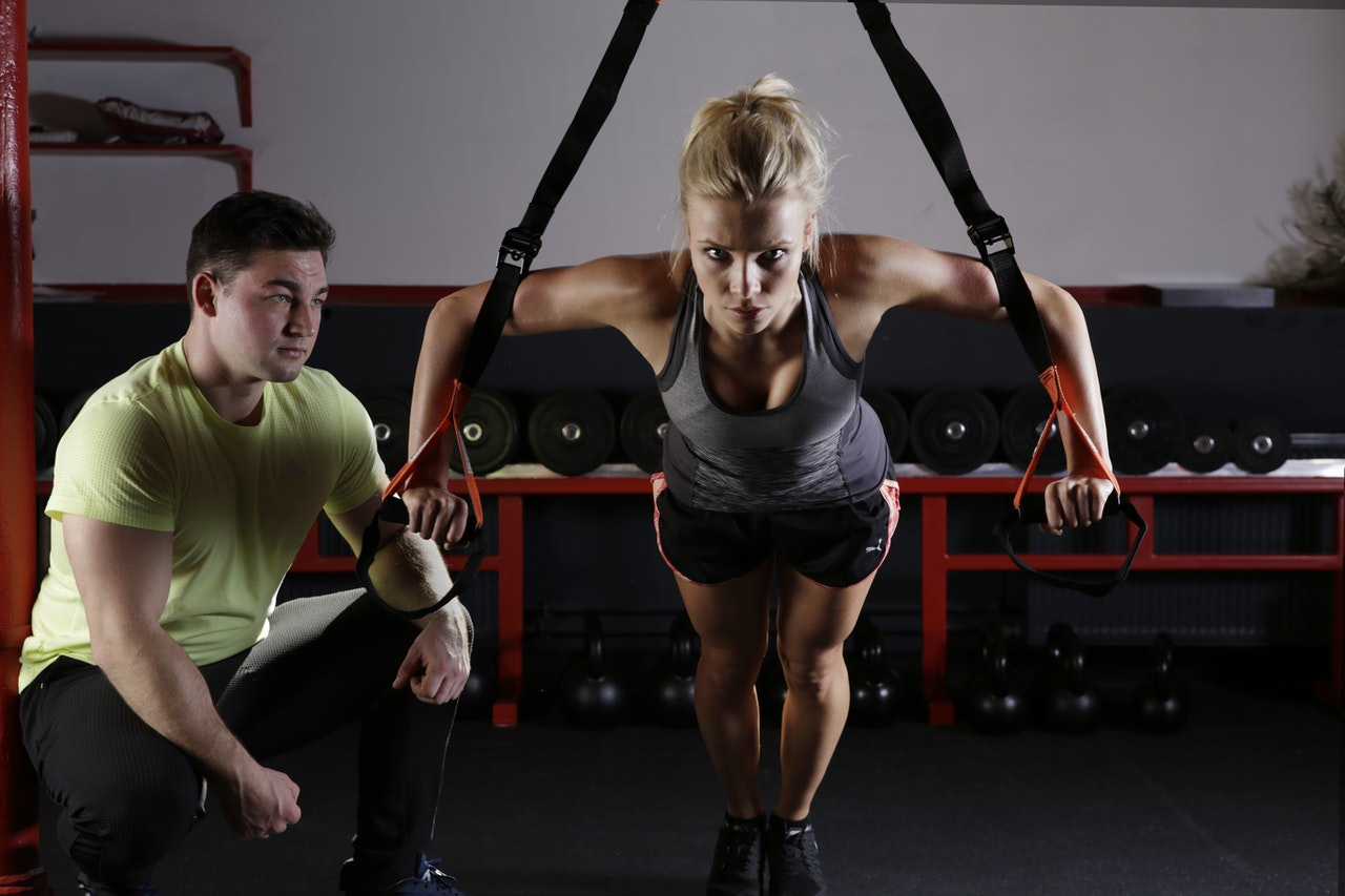 a fitness instructor and his client doing strength training